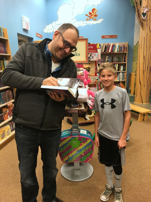 At the B&N Lone Tree where Stel signed copies and personalize a copy, for new fan, Simon.